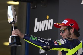 Second-placed Yamaha Factory MotoGP's Italian rider  Valentino Rossi celebrates on the podium of the MotoGP race of the Spanish Grand Prix at the Jerez racetrack in Jerez de la Frontera on May 4, 2014.  AFP PHOTO / JORGE GUERRERO