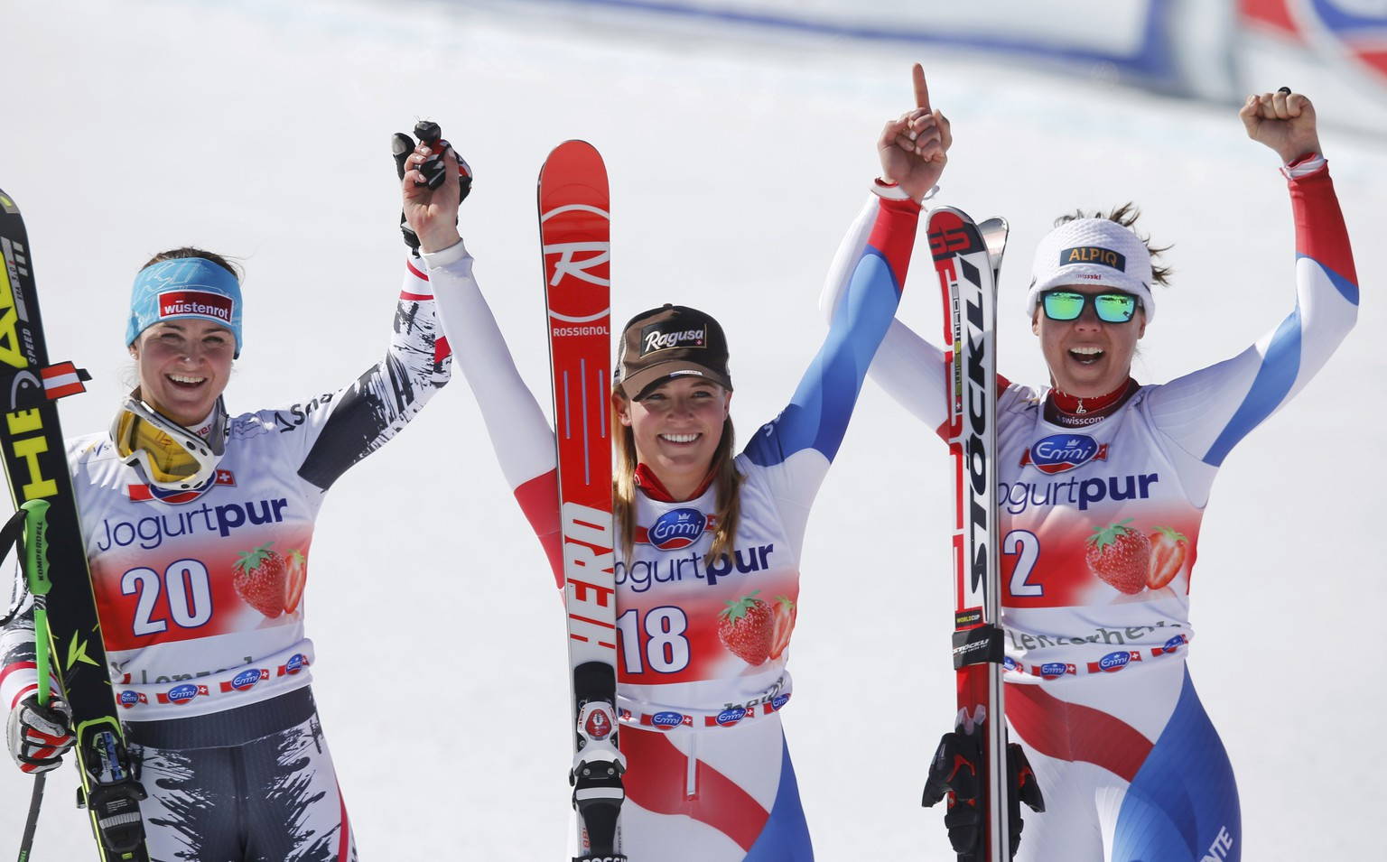 Second placed Elisabeth Goergl of Austria, winner Lara Gut of Switzerland and third placed Fraenzi Aufdenblatten of Switzerland (L-R) celebrate after the women's downhill event during the FIS Alpine Skiing World Cup finals in the Swiss ski resort of Lenzerheide March 12, 2014.             REUTERS/Leonhard Foeger (SWITZERLAND  - Tags: SPORT SKIING)