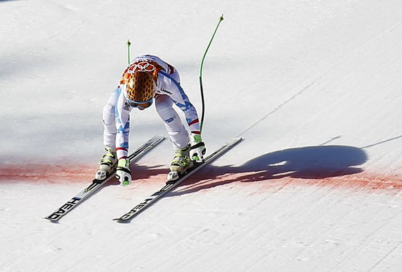 Austria's Anna Fenninger crosses the finish line during the women's alpine skiing Super G competition at the 2014 Sochi Winter Olympics at the Rosa Khutor Alpine Center February 15, 2014. REUTERS/Kai Pfaffenbach (RUSSIA  - Tags: OLYMPICS SPORT SKIING)