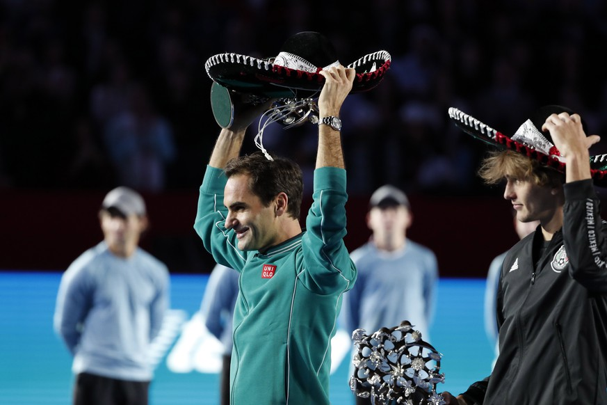 epa08021464 Swiss tennis player Roger Federer (L) and German Alexander Zverev (R) pose for the cameras after an exhibition match at Monumental Plaza de Toros Mexico bullring in Mexico City, Mexico, 23 November 2019 (issued 25 November 2019). The world's largest bullring was transformed into a tennis stadium to host the exhibition match between Federer and Zverev. The match established a new world record 'for attendance at a tennis match', a new record number of 42,517 was reported.  EPA/Jose Mendez