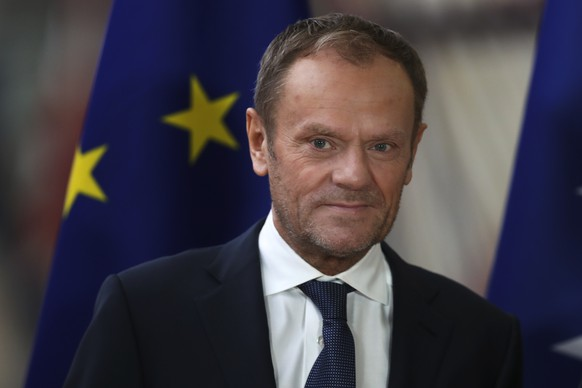 European Council President Donald Tusk poses for the media with members of Bosnia's tripartite presidency before their meeting at the European Council headquarters in Brussels, Wednesday, Jan. 30, 2019. Britain is set to leave the EU in less than two months, but the main sticking point in London to sealing a Brexit agreement is the so-called