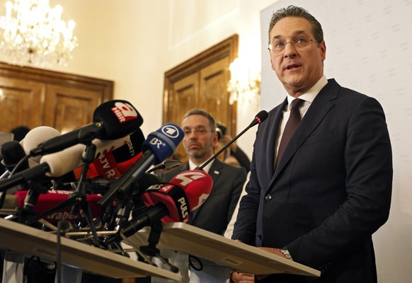 epa07580315 Austria's Vice-Chancellor Heinz Christian Strache (R) of the Austrian Freedom Party (FPOe) gives a statement to journalists as Interior Minister Herbert Kickl (C) listens in the Ministry of Public Service and Sport in Vienna, Austria, 18 May 2019. Austrian Vice Chancellor Strache on 18 May 2019 said he will step down from his post as media caught the far-right FPOe's leader Strache in a corruption allegations scandal. German media have on 17 May 2019 published a secretly recorded video of Strache in Ibiza in July 2017, where Heinz-Christian Strache is claimed to meet an alleged niece of a unknown Russian oligarch who wanted to invest large sums of money in Austria.  EPA/FLORIAN WIESER