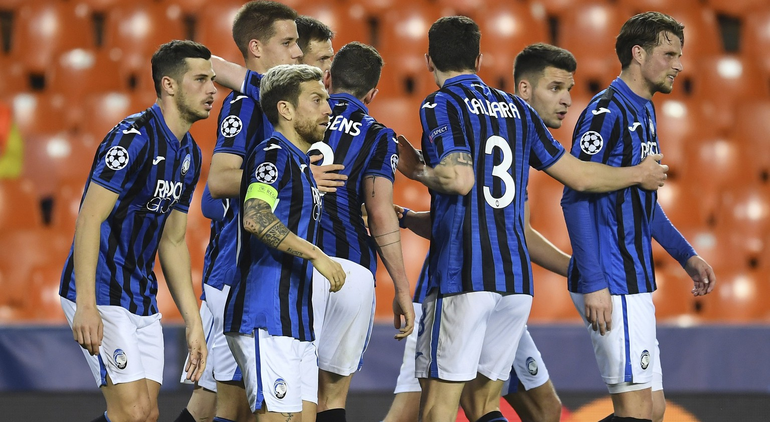 Atalanta's Josip Ilicic celebrates with teammates after scoring a penalty kick his side's second goal during the Champions League round of 16 second leg soccer match between Valencia and Atalanta in Valencia, Spain, Tuesday March 10, 2020. The match is being in an empty stadium because of the coronavirus outbreak. (UEFA via AP)