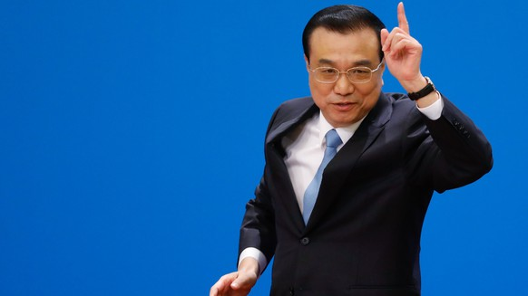 epa06615178 Chinese Premier Li Keqiang gestures at the end of a press conference after the closing of the first session of the 13th National People's Congress (NPC) at the Great Hall of the People in Beijing, China, 20 March 2018. The NPC has over 3,000 delegates and is the world's largest parliament or legislative assembly though its function is largely as a formal seal of approval for the policies fixed by the leaders of the Chinese Communist Party. The NPC runs alongside the annual plenary meetings of the Chinese People's Political Consultative Conference (CPPCC), together known as 'Lianghui' or 'Two Meetings'.  EPA/ROMAN PILIPEY