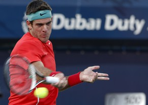 Juan Martin Del Potro of Argentina returns the ball to Somdev Devvarman of India