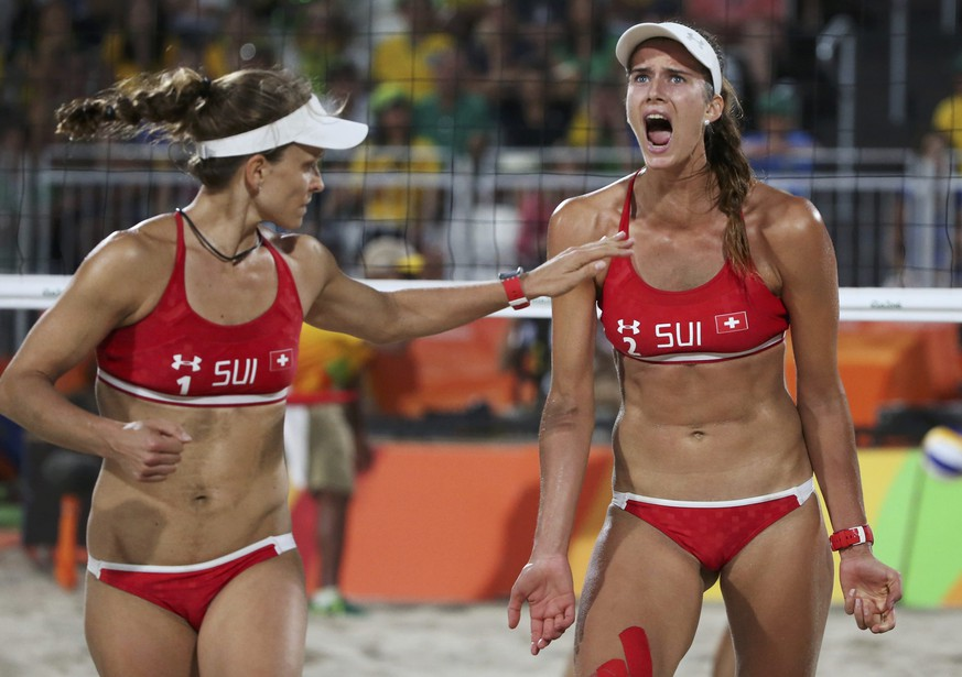 2016 Rio Olympics - Beach Volleyball - Women's Quarterfinal - Beach Volleyball Arena - Rio de Janeiro, Brazil - 14/08/2016. Nadine Zumkehr (SUI) of Switzerland and Joana Heidrich (SUI) of Switzerland react. REUTERS/Adrees Latif (BRAZIL  - Tags: SPORT OLYMPICS SPORT VOLLEYBALL) FOR EDITORIAL USE ONLY. NOT FOR SALE FOR MARKETING OR ADVERTISING CAMPAIGNS.