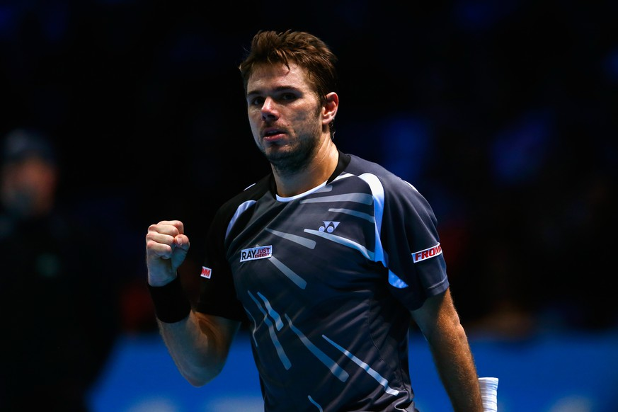 LONDON, ENGLAND - NOVEMBER 14:  Stan Wawrinka of Switzerland celebrates match point in the round robin singles match against Marin Cilic of Croatia on day six of the Barclays ATP World Tour Finals at O2 Arena on November 14, 2014 in London, England.  (Photo by Julian Finney/Getty Images)