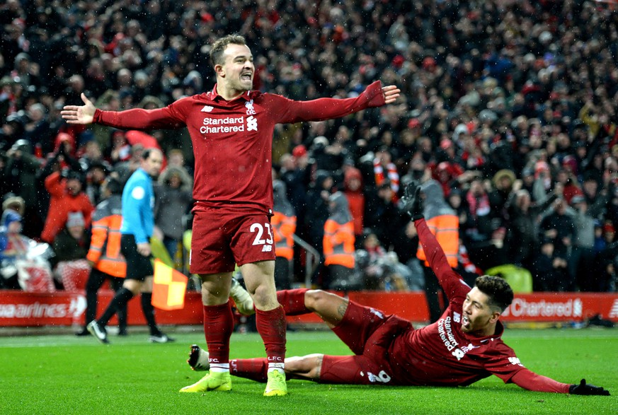 epa07236073 Xherdan Shaqiri (L) of Liverpool celebrates with teammate Roberto Firmino (R) after scoring during the English Premier League soccer match between Liverpool FC and Manchester United FC at Anfield in Liverpool, Britain, 16 December 2018.  EPA/PETER POWELL EDITORIAL USE ONLY. No use with unauthorized audio, video, data, fixture lists, club/league logos or 'live' services. Online in-match use limited to 120 images, no video emulation. No use in betting, games or single club/league/player publications.