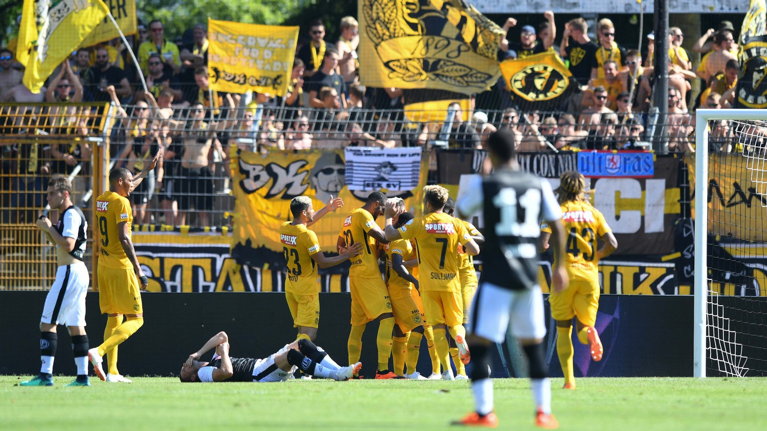 Young Boys's players celebrate the 0-1 during the Super League soccer match FC Lugano against BSC Young Boys, at the Cornaredo stadium in Lugano, Sunday, July 29, 2018. (KEYSTONE/Ti-Press/Davide Agosta)