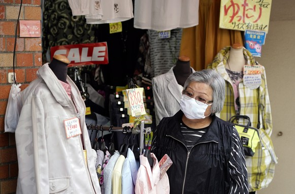 epa08340658 An elderly woman wearing a face mask shops at a clothing store at Sugamo district in Tokyo, Japan, 03 April 2020. Despite the rise of infection cases, Japan's Prime Minister Shinzo Abe said it is not the time to declare state of emergency. The total number of cases accross the country is now exceeding 3000 with a higher increase especially in Tokyo and Osaka urban areas. Countries around the world are taking increased measures to stem the widespread of the SARS-CoV-2 coronavirus which causes the Covid-19 disease.  EPA/FRANCK ROBICHON