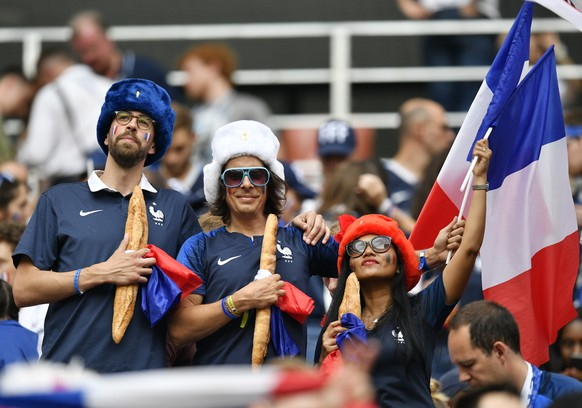 France fans pose with French flags and baguettes prior to the final match between France and Croatia at the 2018 soccer World Cup in the Luzhniki Stadium in Moscow, Russia, Sunday, July 15, 2018. (AP Photo/Martin Meissner)