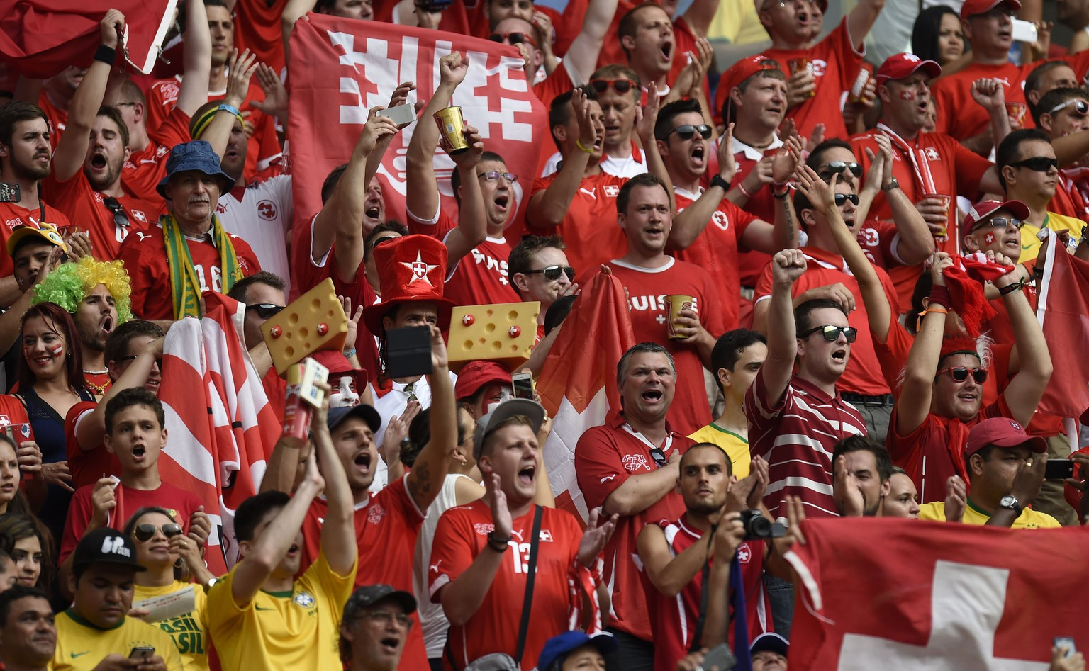 Swiss fans cheer for their team before the start of the Group E football match between Honduras and Switzerland at the Amazonia Arena in Manaus during the 2014 FIFA World Cup on June 25, 2014.  AFP PHOTO / JUAN BARRETO