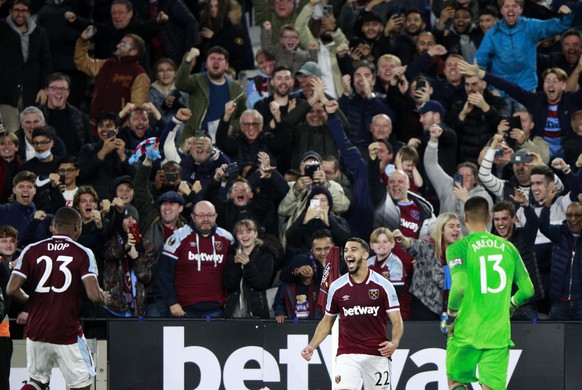 West Ham's Said Benrahma, center, celebrates after scores the winning penalty in a penalty shootout at the end of the English League Cup fourth round soccer match between West Ham United and Manchester City, at the London Stadium, in London, Wednesday, Oct. 27, 2021. (AP Photo/Ian Walton)