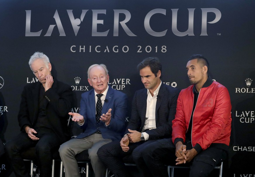 Rod Laver, second from left, responds to a question while promoting The Laver Cup tennis tournament with John McEnroe, left, Roger Federer and Nick Kyrgios, right, Monday, March 19, 2018, in Chicago. (AP Photo/Charles Rex Arbogast)