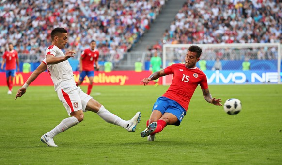 epa06815416 Dusan Tadic (L) of Serbia in action against Francisco Calvo (R) of Costa Rica during the FIFA World Cup 2018 group E preliminary round soccer match between Costa Rica and Serbia in Samara, Russia, 17 June 2018.  (RESTRICTIONS APPLY: Editorial Use Only, not used in association with any commercial entity - Images must not be used in any form of alert service or push service of any kind including via mobile alert services, downloads to mobile devices or MMS messaging - Images must appear as still images and must not emulate match action video footage - No alteration is made to, and no text or image is superimposed over, any published image which: (a) intentionally obscures or removes a sponsor identification image; or (b) adds or overlays the commercial identification of any third party which is not officially associated with the FIFA World Cup)  EPA/WALLACE WOON   EDITORIAL USE ONLY