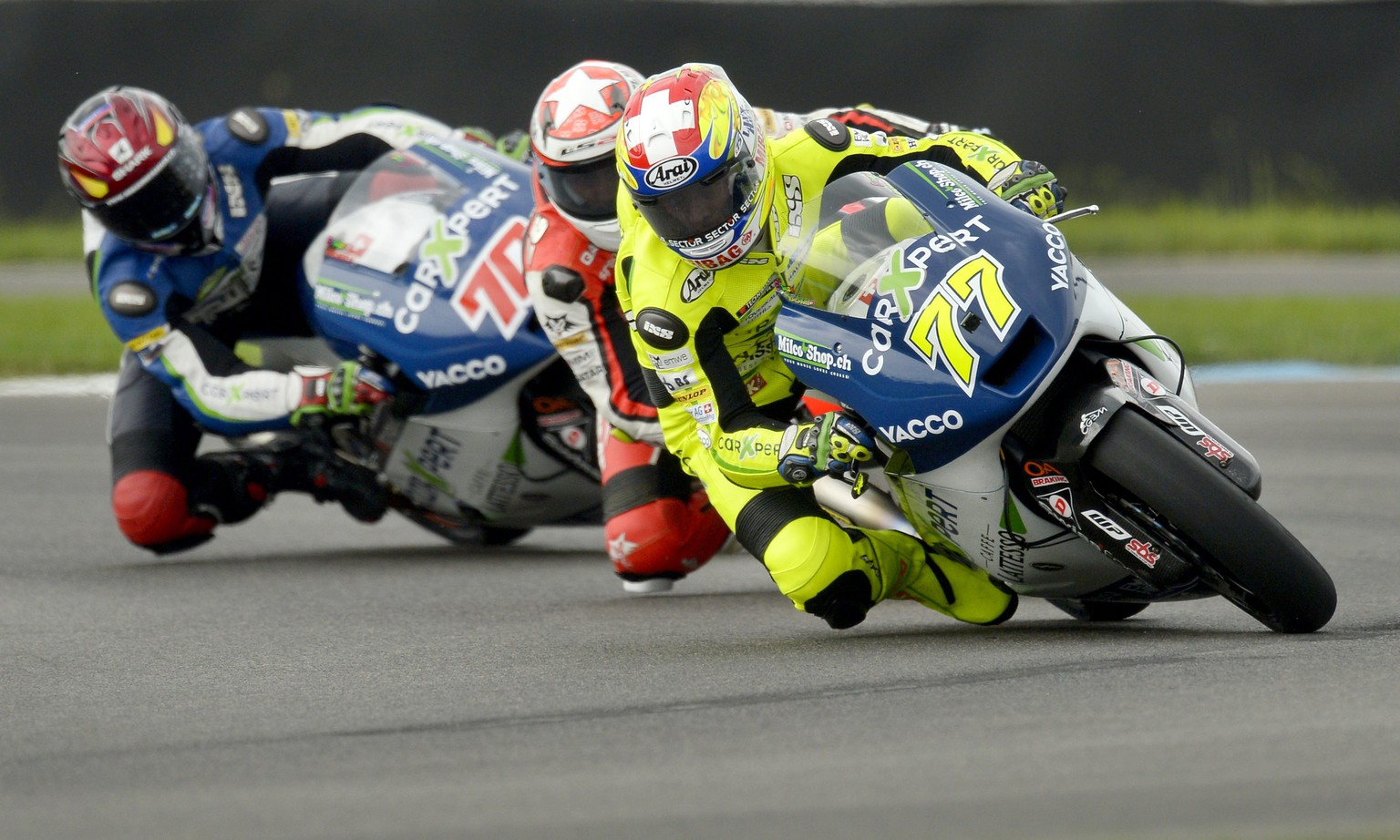 epa04347636 Technomag carXpert team rider Dominique Aegerter of Switzerland navigates turn two, during Moto2 qualifying session at the Red Bull Indianapolis GP at the Indianapolis Motor Speedway in Indianapolis, Indiana, USA, 09 August 2014. Aegerter would qualify third fastest and will start the race on the front row.  EPA/PAUL BUCK