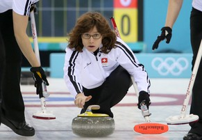 epa04069561 Mirjam Ott (C) of Switzerland delivers a stone during the Round Robin match between Switzerland and Korea in the Curling competition in the Ice Cube Curling Center at the Sochi 2014 Olympic Games, Sochi, Russia, 11 February 2014.  EPA/TATYANA ZENKOVICH