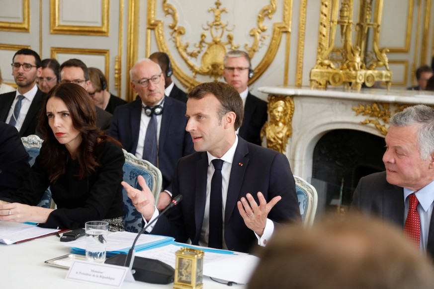 epa07573011 French President Emmanuel Macron (C) and New Zealand's Prime Minister Jacinda Ardern (L) attend a launching ceremony for the 'Christchurch Call' against terrorism at the Elysee Palace in Paris, France, 15 May 2019. A high level summit held in Paris aims at ways to tackle and eliminate terrorism and violent extremist content online. Several world leaders and tech bosses are meeting in Paris to find ways to stop acts of violent extremism from being shown online  EPA/CHARLES PLATIAU / POOL  MAXPPP OUT