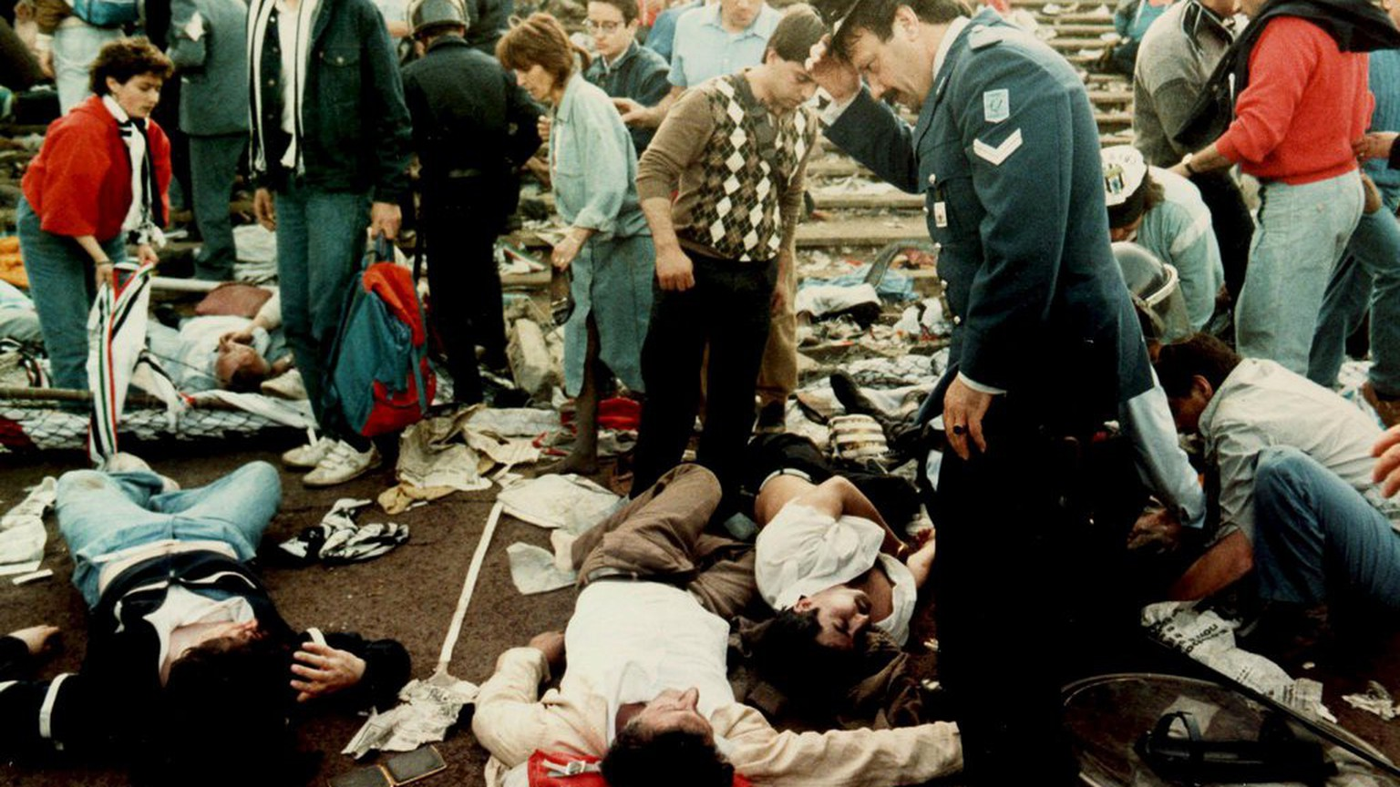 Photo dated 29 May 1985 shows injured spectators in the Heysel stadium in Brussels after violent clashes between Juventus Turin and Liverpool fans prior to the European Champions Cup final. The Heysel stadium tragedy marks one of the darkest moments in the history of soccer.  39 people died and more than 400 were injured when a wall collapsed at the stadium in Brussels during violent riots just before the European cup final between Liverpool and Juventus. As a direct result of this event, the English Football Association banned English clubs from participating in UEFA competitions for six years. (KEYSTONE/EPA/Str)