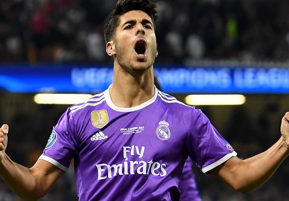 epa06008810 Real Madrid's Marco Asensio celebrates scoring the 4-1 lead during the UEFA Champions League final between Juventus FC and Real Madrid at the National Stadium of Wales in Cardiff, Britain, 03 June 2017.  EPA/ANDY RAIN
