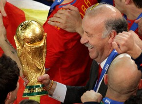 Spain head coach Vicente Del Bosque holds the World Cup trophy at the end of the World Cup final soccer match between the Netherlands and Spain at Soccer City in Johannesburg, South Africa, Sunday, July 11, 2010. Spain won 1-0. (AP Photo/Themba Hadebe)