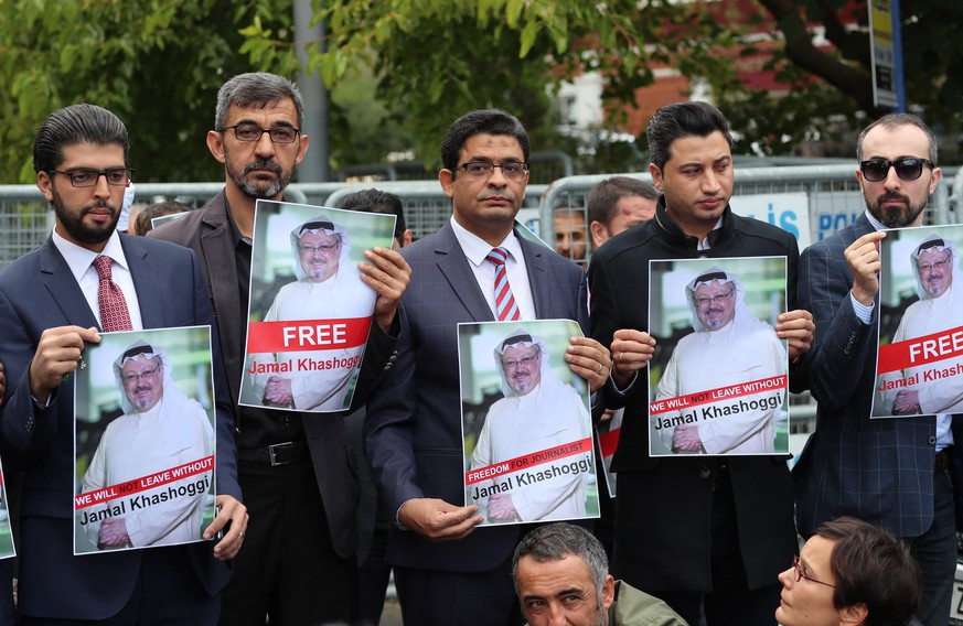 epa07078462 Protesters hold pictures of missing Saudi journalist Jamal Khashoggi during a demonstration organized by Turkish-Arabic Media Association in front of the Saudi consulate in Istanbul, Turkey, 08 October 2018. Turkish President Recep Tayyip Erdogan on 07 October said he is following the developments on the disappearance of Saudi journalist Jamal Khashoggi who has gone missing after visiting the Saudi consulate in Istanbul on 02 October to complete routine paperwork.  EPA/TOLGA BOZOGLU