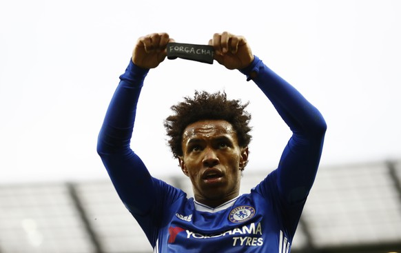 """Britain Football Soccer - Manchester City v Chelsea - Premier League - Etihad Stadium - 3/12/16 Chelsea's Willian celebrates scoring their second goal holds a armband in respect for the victims of the Colombia plane crash containing the Chapecoense players and staff  Action Images via Reuters / Jason Cairnduff Livepic EDITORIAL USE ONLY. No use with unauthorized audio, video, data, fixture lists, club/league logos or """"live"""" services. Online in-match use limited to 45 images, no video emulation. No use in betting, games or single club/league/player publications. Please contact your account representative for further details."""
