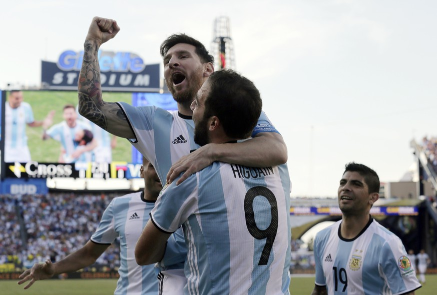 Argentina's Lionel Messi, top, celebrates a goal by Gonzalo Higuain (9) during the first half of a Copa America Centenario quarterfinal soccer match against Venezuela on Saturday, June 18, 2016, in Foxborough, Mass. (AP Photo/Charles Krupa)