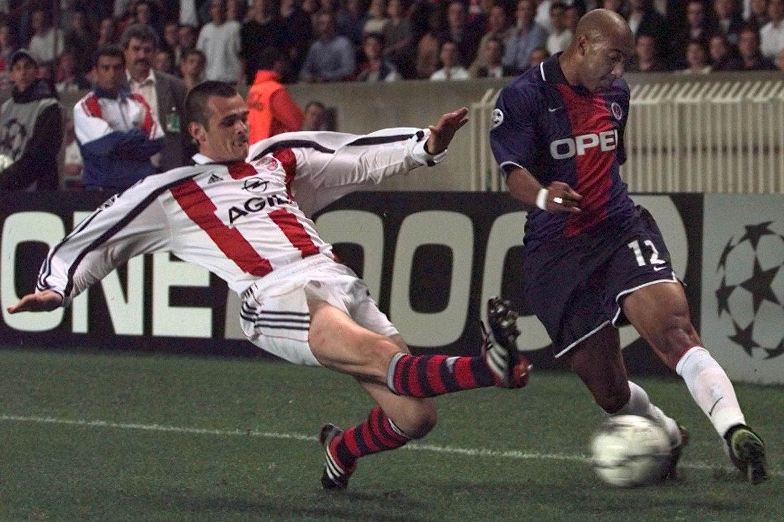 Paris SG player Stephane Dalmat, right, is tackled by an unidentified Bayern player during their Champions League, Group F, soccer match between Paris Saint Germain and Bayern Munich at the Parc des Princes in Paris, Tuesday Sept. 26, 2000.(AP PHOTO/Michel Lipchitz)