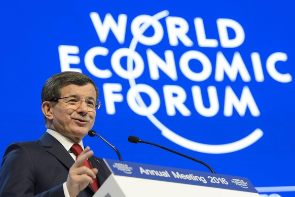 epa05115598 Ahmet Davutoglu, Prime Minister of Turkey speaks during a panel session during the 46th Annual Meeting of the World Economic Forum, WEF, in Davos, Switzerland, 21 January 2016. The overarching theme of the Meeting, which takes place from 20 to 23 January, is 'Mastering the Fourth Industrial Revolution.'  EPA/LAURENT GILLIERON