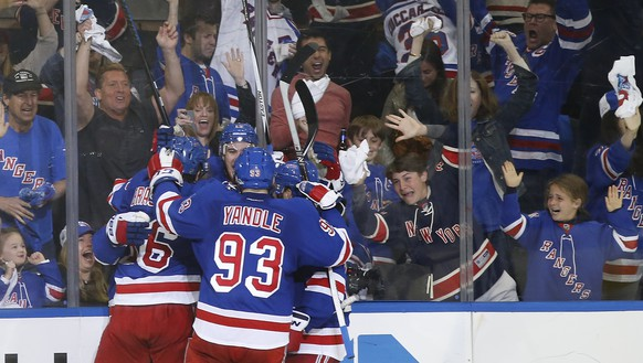 The New York Rangers celebrate a third period goal by center Dominic Moore (28)  in Game 1 of the Eastern Conference finals against the Tampa Bay Lightning in the NHL hockey Stanley Cup playoffs, Saturday, May 16, 2015, in New York. The Rangers won 2-1. (AP Photo/Kathy Willens)