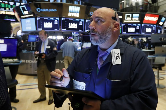Trader Vincent Napolitano works on the floor of the New York Stock Exchange, Monday, July 1, 2019. Wall Street applauded a cease-fire in the U.S. trade war with China and opened trading in July with a bang. (AP Photo/Richard Drew) Vincent Napolitano