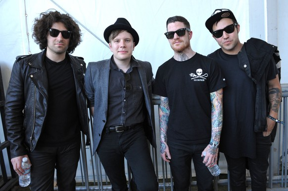 From left, Joe Trohman, Patrick Stump, Andy Hurley, and Pete Wentz of Fall Out Boy pose backstage at the second weekend of the 2013 Coachella Valley Music and Arts Festival at the Empire Polo Club on Saturday, April 20, 2013 in Indio, Calif. (Photo by John Shearer/Invision/AP)