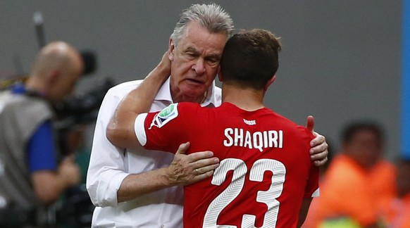 Switzerland's coach Ottmar Hitzfeld (L) embraces Xherdan Shaqiri after he was substituted during their 2014 World Cup Group E soccer match against Honduras at the Amazonia arena in Manaus June 25, 2014. REUTERS/Michael Dalder (BRAZIL  - Tags: SOCCER SPORT WORLD CUP)
