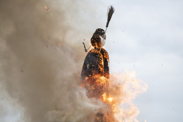 "The head of the ""Boeoegg"" burns on the Sechselaeuten place in Zurich, Switzerland, pictured on April 16, 2018. The Sechselaeuten (ringing of the six o'clock bells) is a traditional end of winter festival with a parade of guilds in historical uniforms on horseback and the burning of the Boeoegg, a symbolic snowman, at 6 pm. The faster the Boeoegg explodes, the hotter the summer will be according to traditional weather rules. (KEYSTONE/Patrick Huerlimann)"