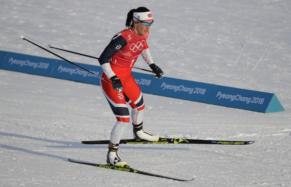 Marit Bjoergen, of Norway, competes in the women's team sprint freestyle semifinal cross-country skiing competition at the 2018 Winter Olympics in Pyeongchang, South Korea, Wednesday, Feb. 21, 2018. (AP Photo/Kirsty Wigglesworth)