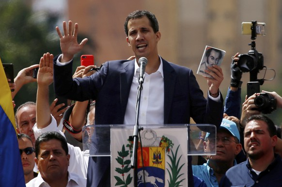Juan Guaido, head of Venezuela's opposition-run congress, declares himself interim president of Venezuela, during a rally demanding President Nicolas Maduro's resignation in Caracas, Venezuela, Wednesday, Jan. 23, 2019. (AP Photo/Fernando Llano)