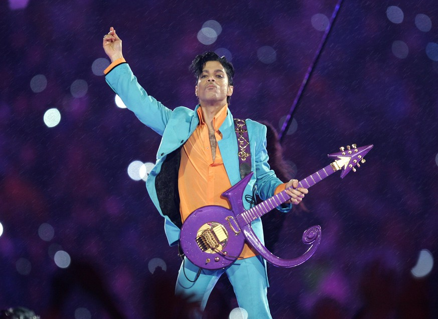 FILE - In this Feb. 4, 2007 file photo, Prince performs during the halftime show at the Super Bowl XLI football game at Dolphin Stadium in Miami.   The entertainment assets of Prince's estate will be managed by two key figures in his career. L. Londell McMillan, the artist's longtime attorney, manager and friend, and business executive Charles A. Koppelman have been chosen for the task by the court-approved special administrator. Bremer Trust National Association confirmed Thursday, June 16, 2016,  it was retaining the pair. The decision was first reported by the music magazine The Source, which is owned by McMillan.(AP Photo/Chris O'Meara, File)
