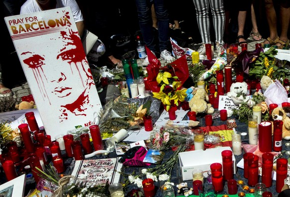 epa06149877 Tributes to victims outside the Liceu Theatre, on the site of a deadly van attack in Barcelona, Spain, 18 August 2017. According to media reports, at least 14 people have died and 130 were injured when a van crashed into pedestrians in Las Ramblas, downtown Barcelona in an incident which Spanish police are treating as a terror attack. Similar attack was conducted in coastal city of Cambrils, where five alleged terrorists, who apparently wore bomb belts, were shot dead by security forces on early morning 18 August after they attacked pedestrians using a vehicle next to a promenade, killing one and injuring six people, including a police officer. Police have stated that the attack in Barcelona and the attack in Cambrils are linked. The Islamic State (IS) has claimed the responsibility for the attack in Barcelona.  EPA/QUIQUE GARCIA