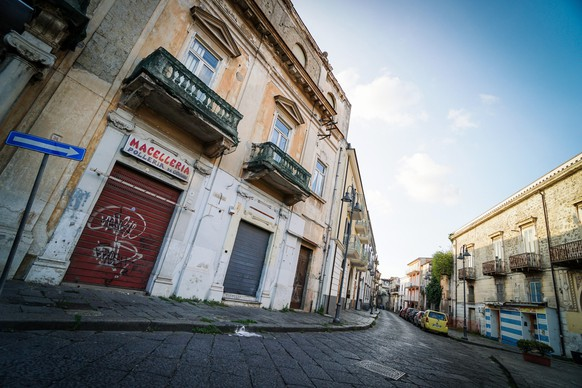 epa08773388 A view of empty streets of the Orta di Atella comune that was declared 'red zone' after an increase of coronavirus Covid-19 cases, in Campania region, Naples, Italy, 25 October 2020. Authorities in worst-infected regions, including Lombardy, Campania and Lazio, have imposed tougher local measures to stem the spread of the SARS-CoV-2 coronavirus which causes the COVID-19 disease.  EPA/CESARE ABBATE
