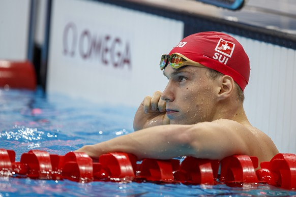 epa09373558 Roman Mityukov of Switzerland reacts after competing in the men's 200m Backstroke Heats during the Swimming events of the Tokyo 2020 Olympic Games at the Tokyo Aquatics Centre in Tokyo, Japan, 28 July 2021.  EPA/Patrick B. Kraemer