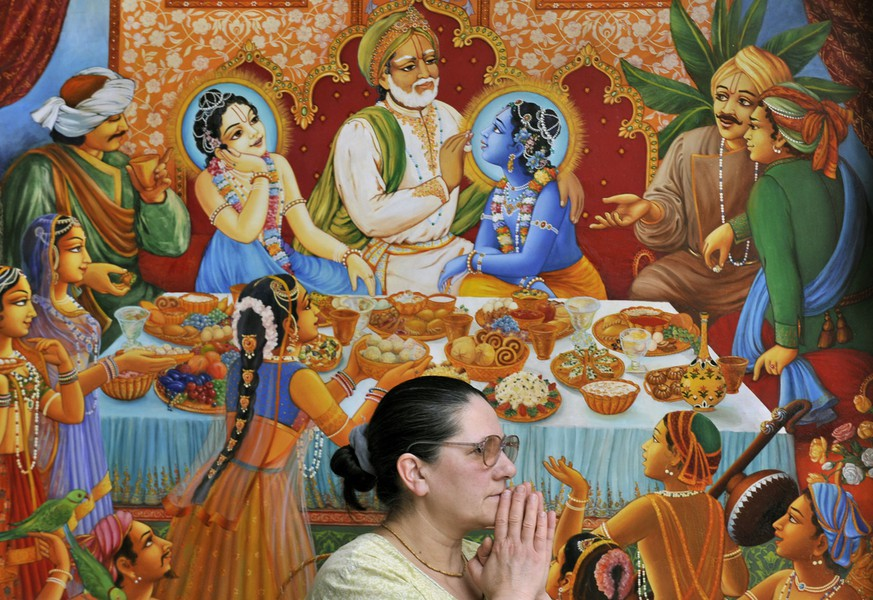 A Krishna worshiper attends a temple service in the Krishna Valley of Somogyvamos (180km/110miles south-west of Budapest) Hungary, Sunday, Feb. 8, 2009. Some 200 of Krishna believers live separated from the mainstream society in the Krishna Valley. In the 250-hectare estate, which is run by the International Society of Krishna Consciousness, believers make a sustainable farming producing all food and ingredients by themselves and they live according to their own rules. Beside presenting the cultural attractions of India, the Krishna Valley offers a spiritual experience pervaded by the mood of simple living, high-thinking, from farming to Indian style dressing, gastronomy, music and temple worship. (AP Photo/Bela Szandelszky)