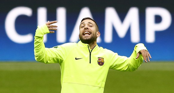 Barcelona's Jordi Alba gestures, during a training session at the Allianz Arena in Munich, southern Germany, Monday, May 11, 2015.  FC Bayern Munich will play against FC Barcelona in a second leg semifinal Champions League soccer match on Tuesday. (AP Photo/Matthias Schrader)