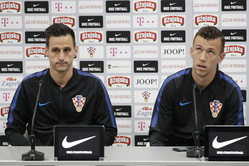epa06805045 Croatia's Nikola Kalinic (L) and Ivan Perisic  attend a press conference of the Croatian national soccer team at the Roschino Arena, outside St. Petersburg, Russia, 13 June 2018. Croatia prepares for the FIFA World Cup 2018, that will take place in Russia from 14 June to 15 July 2018.  EPA/ANATOLY MALTSEV
