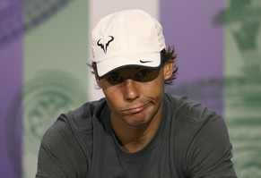 Rafael Nadal of Spain attends a news conference after being defeated by Nick Kyrgios of Australia in their men's singles tennis match at the Wimbledon Tennis Championships, in London July 1, 2014.                 REUTERS/Scott Heavey/AELTC/Pool   (BRITAIN - Tags: SPORT TENNIS TPX IMAGES OF THE DAY)