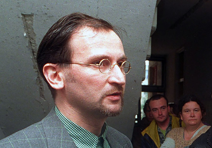 FILE - In this file photo dated Saturday, May 2, 1998, Jozsef Szajer, vice-president of the Fidesz Hungarian Civic Party, talks to the media.  Hungarian member of the European Parliament Jozsef Szajer on Tuesday Dec. 1, 2020, admitted to being among those present at an illegal party broken up by Belgian police in central Brussels last week, amid press reports he took part in a COVID-19 lockdown sex orgy. (AP photo/Tibor Rozsahegyi, FILE)