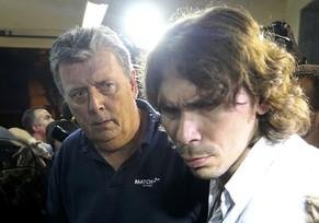 Ray Whelan (L), of Switzerland-based Match Services, arrives at a police station after being arrested in Rio de Janeiro July 7, 2014. Police in Rio de Janeiro on Monday arrested the chief executive of the Swiss hospitality and ticketing company in connection with an ongoing investigation over VIP ticket scalping at the World Cup.