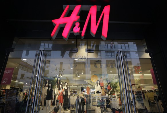 FILE - In this May 31, 2013, file photo, an H&M store is shown in New York.  Swedish low-cost fashion brand Hennes & Mauritz AB said Tuesday, March 27, 2018, that its first-quarter profit plummeted 44 percent after it was forced to cut prices and make markdowns due to higher than expected garment inventories. (AP Photo/Mark Lennihan, File)