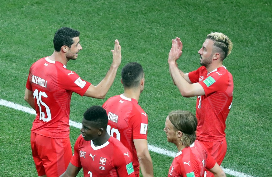 epa06845790 Josip Drmic of Switzerland (R) celebrates scoring the 2-1 with teammates during the FIFA World Cup 2018 group E preliminary round soccer match between Switzerland and Costa Rica in Nizhny Novgorod, Russia, 27 June 2018.