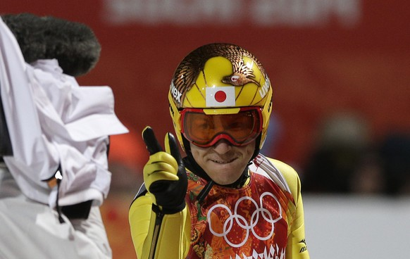 Japan's Noriaki Kasai celebrates after his first attempt during the ski jumping large hill final at the 2014 Winter Olympics, Saturday, Feb. 15, 2014, in Krasnaya Polyana, Russia. (AP Photo/Matthias Schrader)
